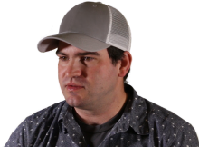 Head and shoulders shot of Eric, a young, clean-shaven man wearing a baseball hat